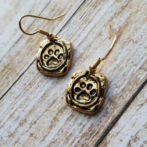 Burnished gold tone paw print earrings